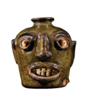 The original 19th-century face jug from Edgefield, South Carolina. Courtesy of the Chipstone Foundation.