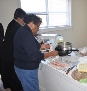 These ladies were preparing a full course breakfast while Rev. Elvin Thompson talked about his research on Black education.
