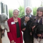 Henrietta Humphreys greets Starkey Flythe and two visitors who brought special canine guests.