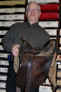 Richard Killen brings a saddle home.