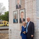 Ms. Mary Edwards & son Robert viewing murals.