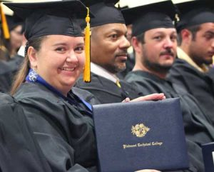 Piedmont Technical College recognized more than 300 students who received certificates, diplomas and associate degrees during spring commencement exercises May 9 at the James Medford Family Event Center. Building construction technology graduate Tara Lindley of Clinton proudly displays her degree.