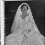 Jean in her Priscilla of Boston wedding dress.  The trim is white leaves scattered on the neckline and emphasizing the lines of the full skirt of white silk satin.
