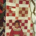 This was the first quilt that JO Ann made and the first quilt show in which she exhibited.  It was made for her daughter Elizabeth who is standing in front, at age 6.