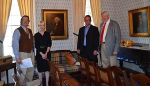 Society President William Morgan Benton, Blocker descendants Amy Geer and Will Geer and Society Historian Bettis C. Rainsford in front of the newly-acquired portraits of John Blocker, Sr. (1749-1814) and John Blocker, Jr. (1778-1836).
