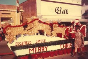 The Jaycees float in a 70s parade.