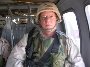 Virgil Huston on a Blackhawk helicopter going to Baghdad in March, 2005.