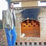 Justin Guy stands near the opening of the kiln on Dec. 7.