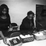 Deidra T. Johnson, Myrtis Walker (Advisor) and Tiffini Tillman assembling baskets.