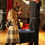 Alissa Claire Rhodes and her father with magic tricks.