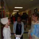Colonial ladies, Jenna English, Linda Johnson, and TyLajia Wakefield sharing a moment in history.