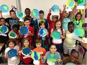 Mrs. Parker's 4th grade students holding their Earth Day promises.