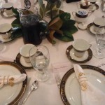 "Tables were set with members' fine china and silver, and the magnolias and sweet tea emphasized the ""Southern Belle"" theme (Doris Rhodes's table settings)."