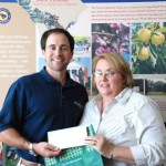 Matt Riddle presents grant check to Donna C Livingston with the Edgefield County Chamber of Commerce