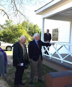 Ambassador Cooper points to the building; he and his family gave the building and grounds.