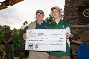 NWTF CEO George Thornton presents an NWTF scholarship to youth participant, Alex Richardson