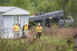Emergency responders in the yard of Kim and Joni Outlaw at the scene of April 10, 2015 derailment of a Norfolk Southern freight train near Salter's Pond Road in Trenton, S.C. Photo Credit: Robert H. Norris, III/Advertiser Staff