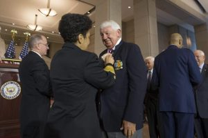 "Frank Feltham is photographed being pinned, the pin noting ""A Grateful Nation Thanks and Honors You."" Submitted photo"