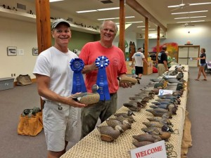 Tim (right) and Marc from Raleigh with the co-carved rig of blue wing teal that took first in marsh ducks and best in show.