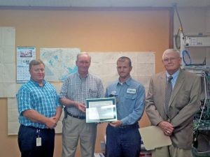 L to R: Don Smoak and Mart Adams, SCE&G; Senior Airman Jonathon McKay of the US Air Force Reserve and SCE&G Apprentice Lineman; Luther K. Beason, ESGR Representative.
