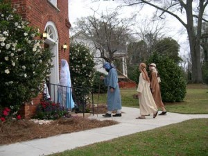 Mary, Joseph and Shepherds enter the Trinity Episcopal in the 2011 Tour of Churches.