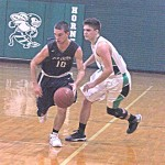 Fox Creek senior Caleb Veihman (10) dribbles around a Dixie defender. Predator's win 46-42