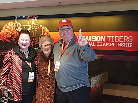 Johnston native and Clemson fan Eva Holmes is flanked by her children Vangie and Lewis in Arizona at the National Championship.