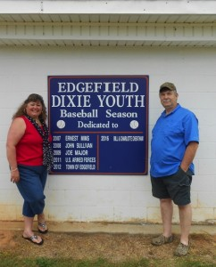 Pictured are Charlotte and Bill Cheatham next to the sign dedicating the Edgefield.