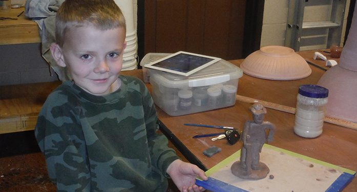 Youths Work with Clay at Local Studio