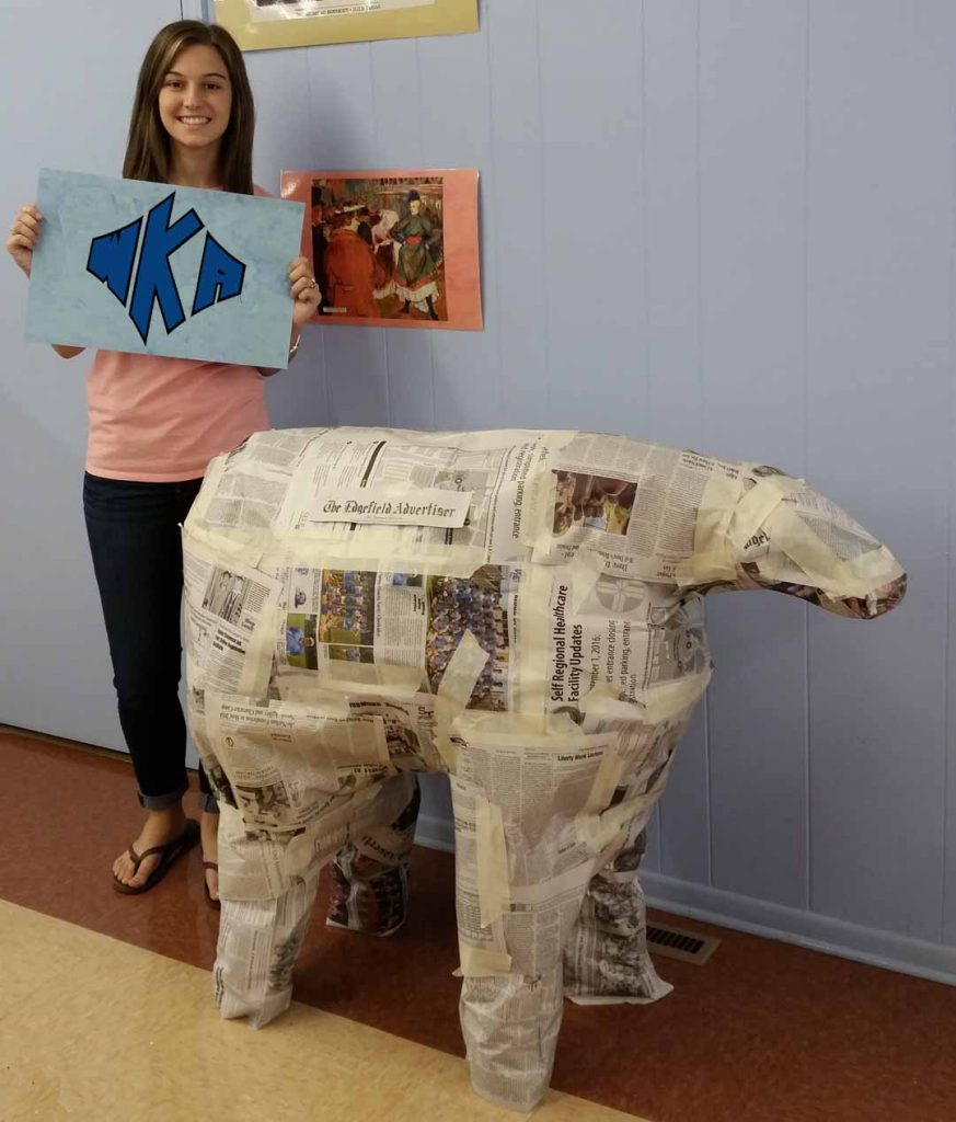 Pictured with the Edgefield Advertiser cow is Peighton Rienzo.