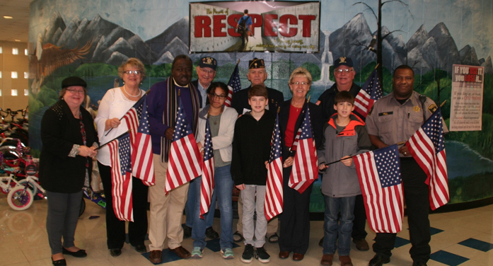 Left to right front: Mrs. Vernon Holmes, Principal Debbie Courtney, Guidance Counselor Nathaniel Haynes, Danielle Herring, Jack Kornaus, Post 30 Adjutant Jane Doolittle, Charles Jones and Resource Officer Archie Hill Left to right back: Members of Post 30, Mr. Jimmy Painter, Mr. Ken Hartkopf and Mr. Roger Ellis.