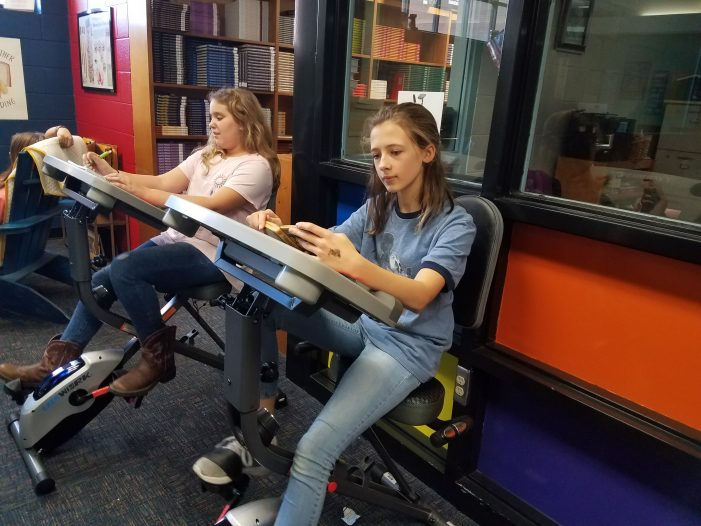 Spinning in the Stacks: J-E-T's Media Center Adds Exercise Bikes